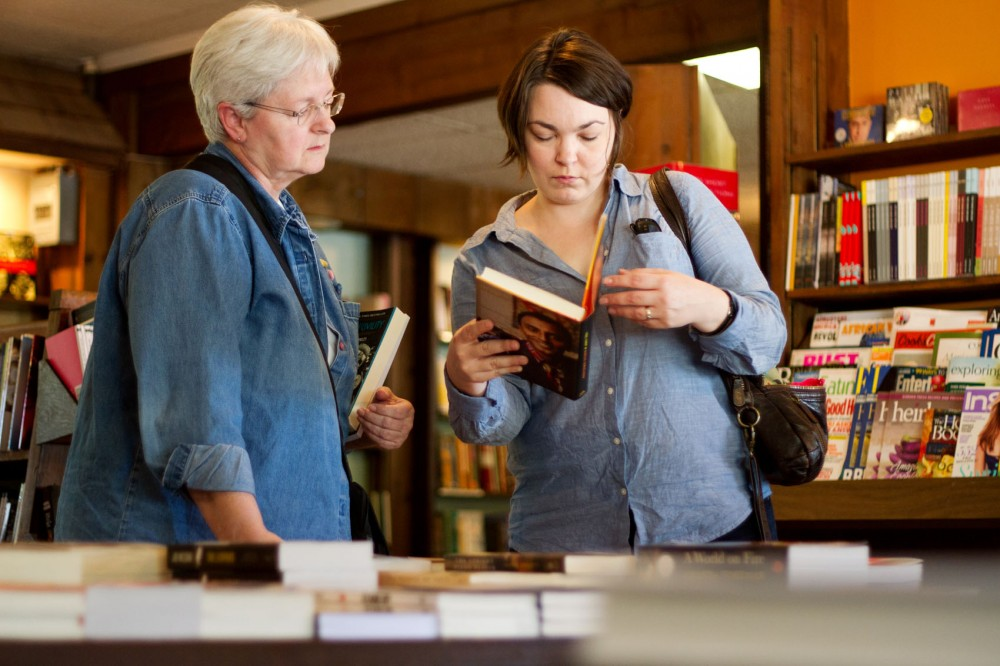 Judi Steltzner, left, and her daughter Gretchen Funk browse books Saturday afternoon at Micawber's Books in St. Paul. The bookstore is part of the