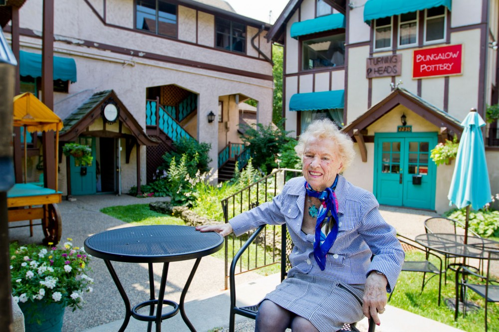 Mary Ann Milton (cq/source), owner of Milton Investment Company, sits in the courtyard of Milton Square on Monday in St. Anthony Park in St. Paul. Milton bought the property in 1957 and has since been the owner and developer.
