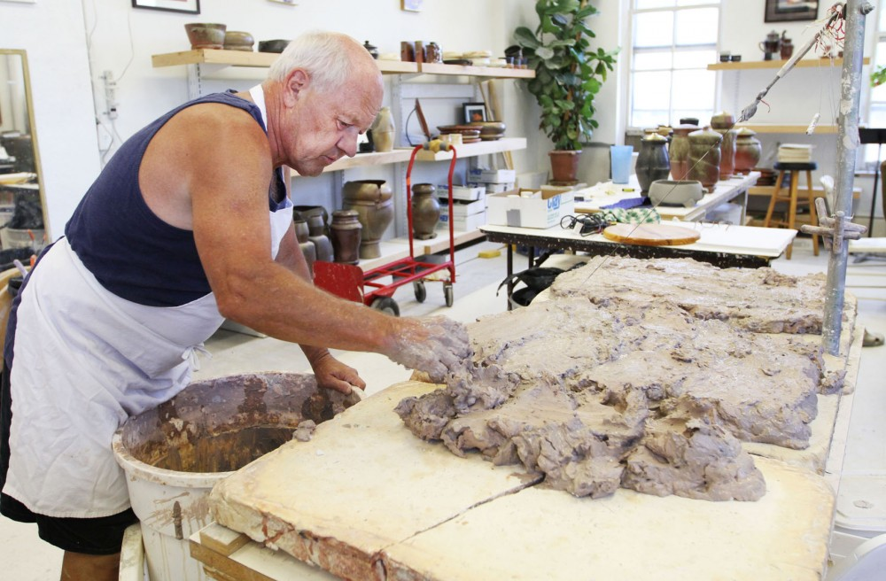 Pottery artist Chuck Solberg preps a batch of clay in his studio Monday. Solberg moved his studio to 2010 E. Hennepin Ave. two years ago after he was forced to move out of his space at Raymond and University avenues due to light-rail construction.