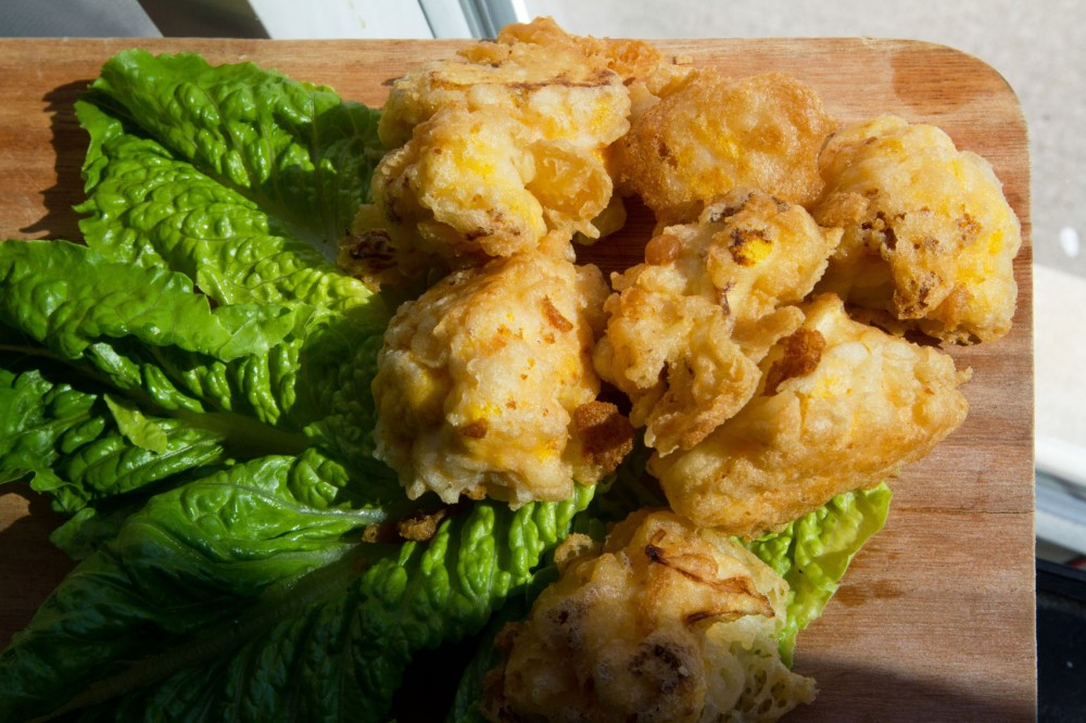 Beer-battered yellow cauliflower create convenient treats for watching the Olympics. The beer batter, which can be used on more than just vegetables, is made of beer, onion, carrot, flour and salt.