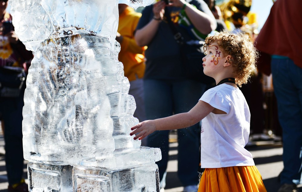 Mikayla Orbin, 2, examines a frozen statue of Goldy Gopher on Saturday morning outside TCF Bank Stadium.