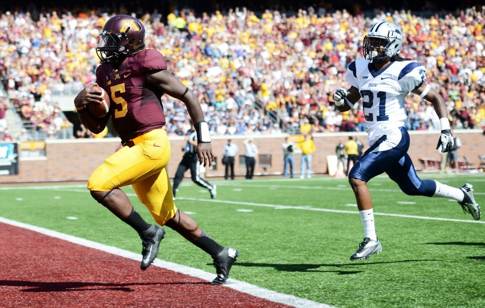 Minnesota quarterback MarQueis Gray dashes into the Wildcats' end zone for a touchdown during Saturday's game against New Hampshire at TCF Bank Stadium. Gray ran for 109 yards and a pair of touchdowns.