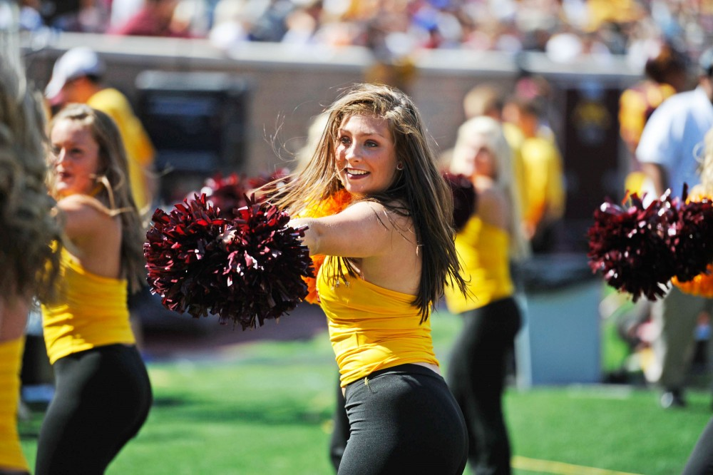 Dance team members perform during Saturday's game against New Hampshire at TCF Bank Stadium.