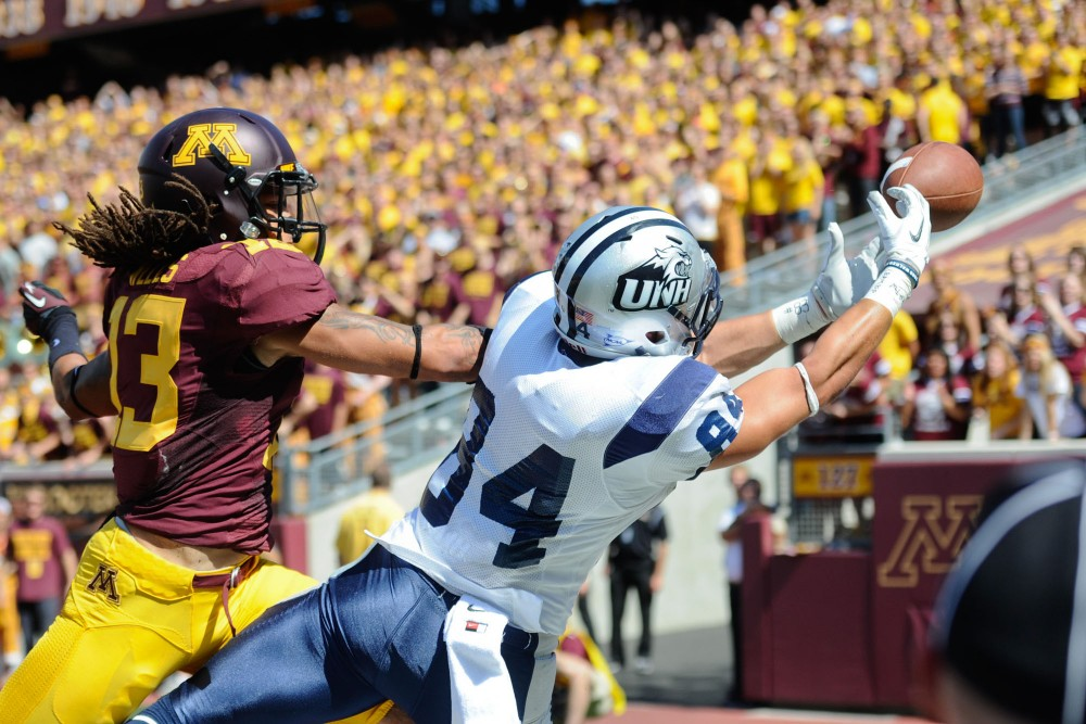 Minnesota defensive back Derrick Wells disrupts a pass intended for New Hampshire wide receiver Joey Orlando on Saturday at TCF Bank Stadium.