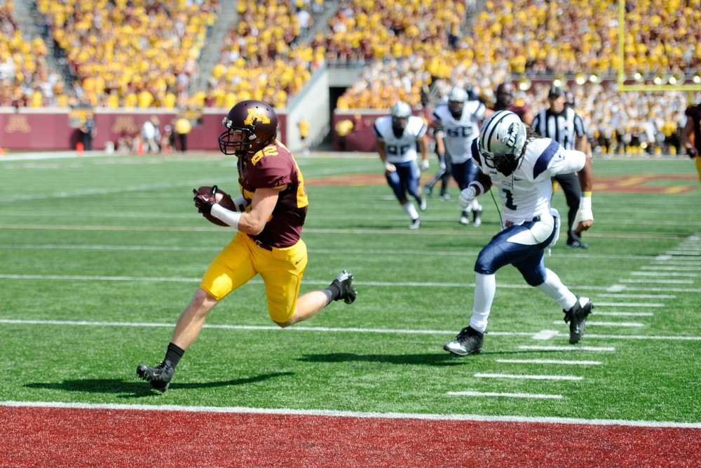 Minnesota wide receiver A.J. Baker runs into the New Hampshire end zone for a touchdown Saturday at TCF Bank Stadium.