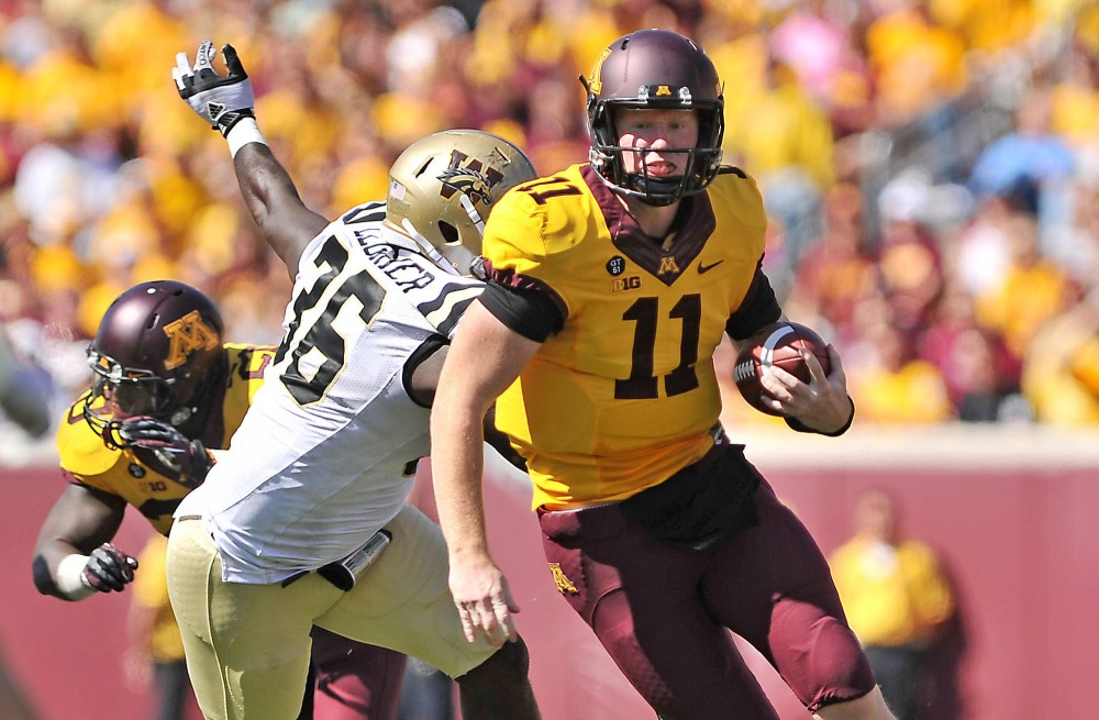 Minnesota quarterback Max Shortell charges towards Western Michigan's end zone Sept. 15 at TCF Bank Stadium.