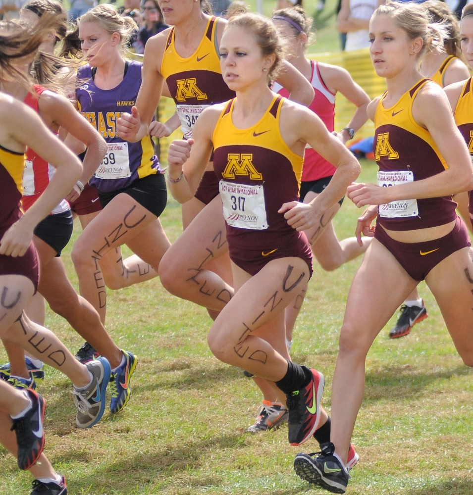 Freshman Molly Kayfes, center, runs beside Senior Stephanie Price Saturday, Sept. 24th in the Roy Griak Invitational on the St. Paul Campus.