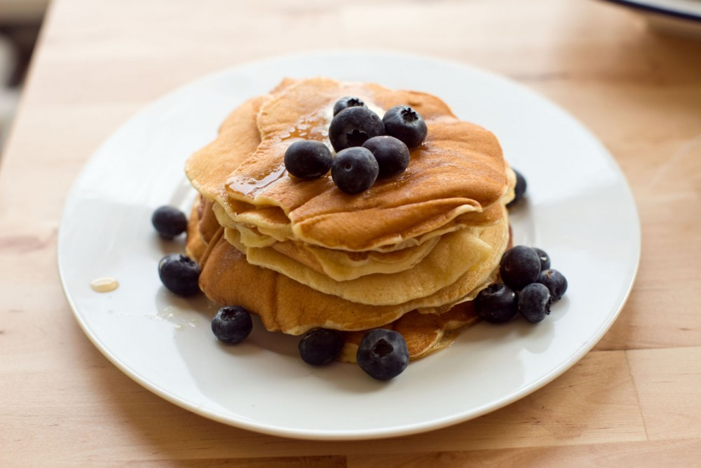 Pancakes are stacked up and ready to eat. These were made using expired sour milk.
