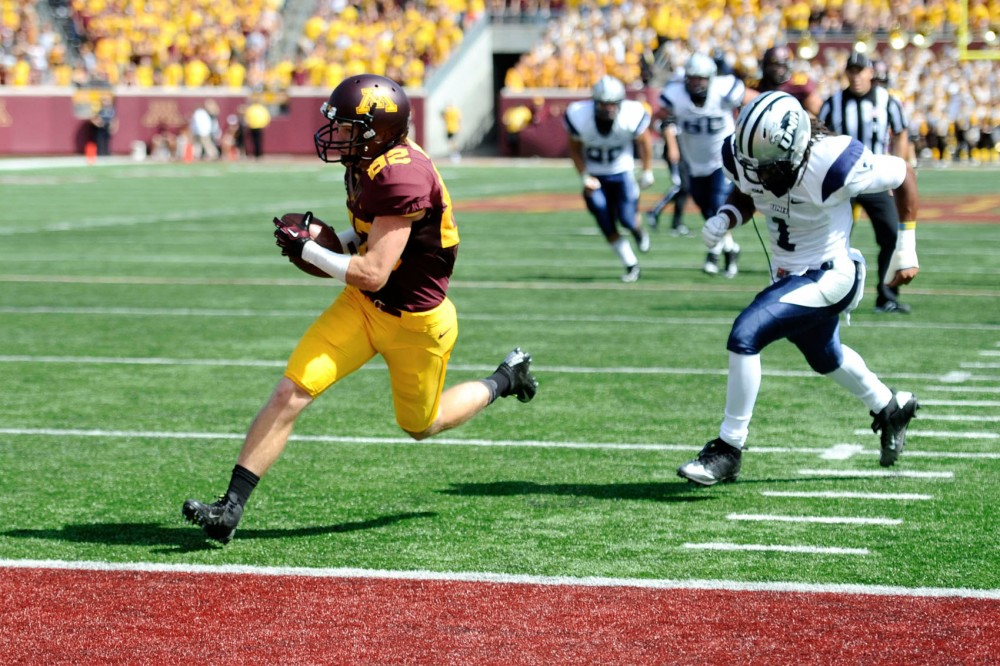 Minnesota wide receiver A.J. Barker scores a touchdown Saturday at TCF Bank Stadium.
