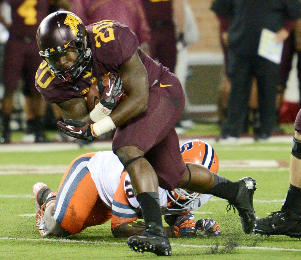 Minnesota running back Donnell Kirkwood escapes Orange line backer Siriki Diabate on Saturday at TCF Banks Stadium.