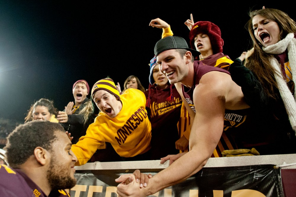 Fans celebrate Saturday night at TCF Bank Stadium after the Gophers' fourth-straight win. Minnesota's 17-10 win over Syracuse moved the team to 4-0 for the first time since 2008.
