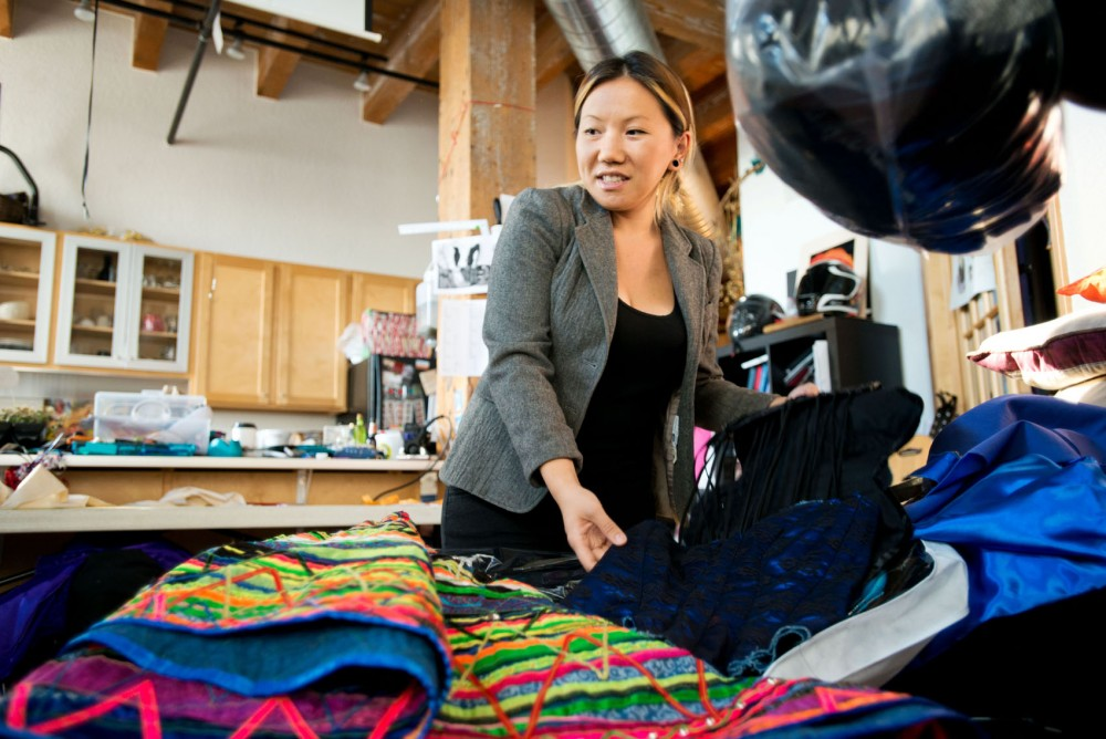 Designer Oskar Ly displays one of her vibrant pieces at her studio in St. Paul. The skirt she has the traditional vibrant colors of Hmong culture. Ly will be displaying her looks with other designers at the upcoming Hmong Fresh Traditions fashion show.