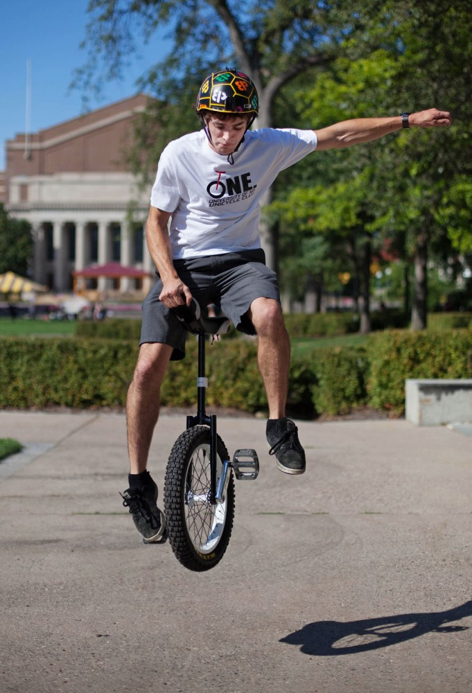 Founder and president of the Unicycle Club Brent Barghahn performs a trick on his unicycle during the clubs first officer meeting of the year Monday on Northrop Mall. Brent also holds the record for longest unicycle rail grind, 34 feet 3 inches, in the Guinness World Records database.