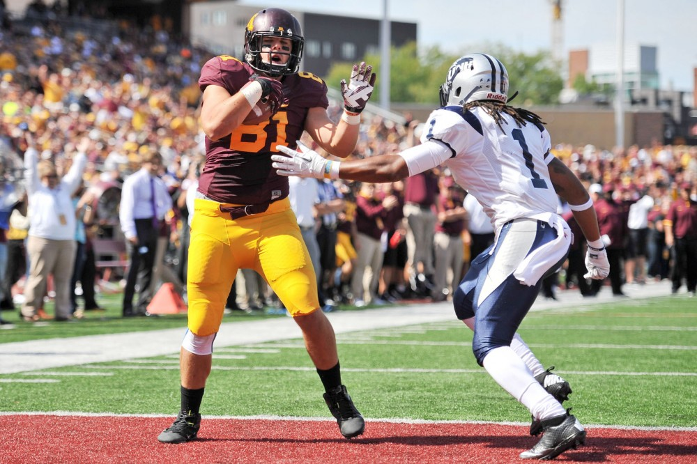 Minnesota tight end John Rabe scores a two-yard touchdown against New Hampshire on Sept. 8 at TCF Bank Stadium. Rabe has already surpassed his totals last season in catches, yards and touchdowns.