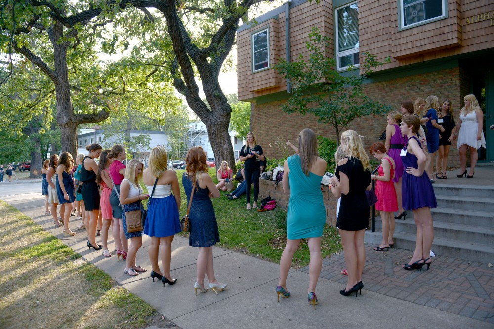 Women interested in joining the University of Minnesota's greek community lined up outside of Alpha Gamma Delta Monday night for the last night of sorority recruitment.