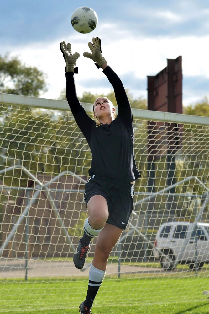 Jackie Voigt transitioned from playing on the women's basketball team to being a goalie on Minnesota's soccer team.