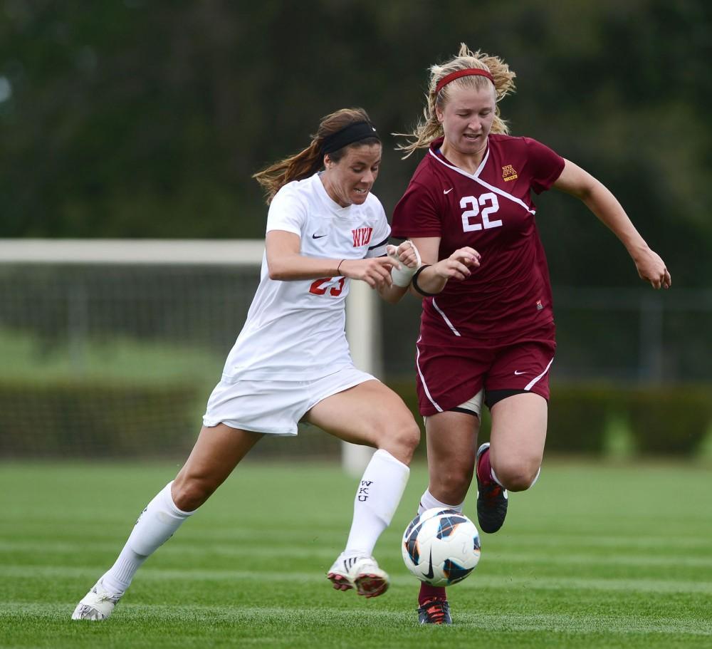 Minnesota midfielder Lauren Bauer fights for the ball against Western Kentucky forward Amanda Buechel Sept. 3 at Elizabeth Lyle Robbie Stadium.
