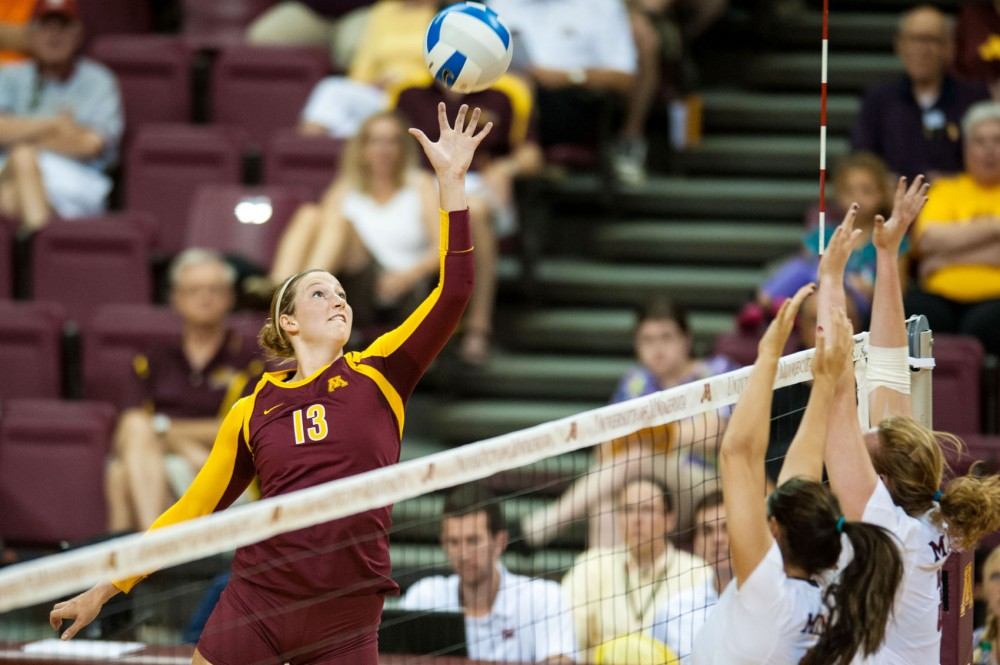 Minnesota outside hitter Ashley Wittman tips a ball over the net against Miami on Saturday at the Sports Pavilion.
