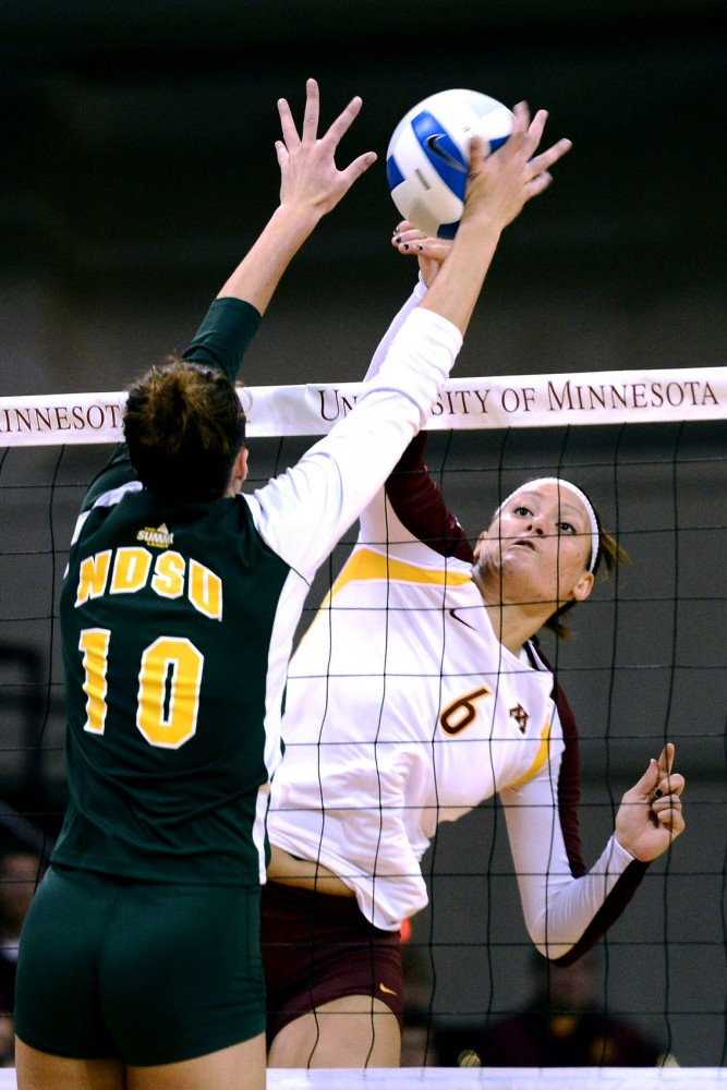Minnesota middle blocker Tori Dixon spikes during a game against North Dakota State Monday at the Sports Pavilion. Dixon had 15 kills with two aces and threes block assists.