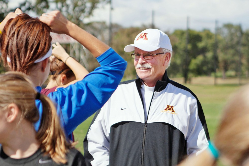Head women's cross country coach Gary Wilson coaches his team at practice Wednesday at Les Bolstad Golf Course in Falcon Heights, Minn. Wilson has won six Big Ten championships for Minnesota in track & field and cross country.