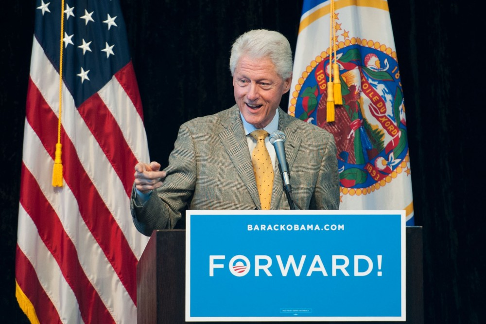 Former President Bill Clinton speaks in support of President Barack Obama and other Democratic candidates Tuesday morning at McNamara Alumni Center. Clinton's visit marked the third straight day of visits by Democratic campaigners to campus ahead of next Tuesday's elections.