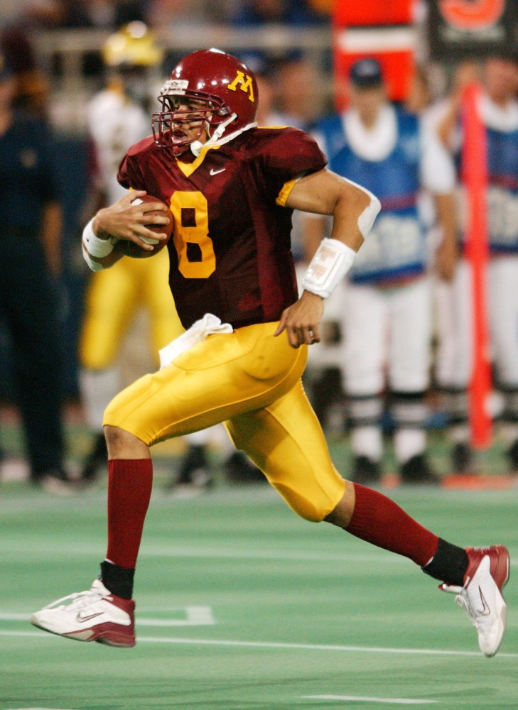 Minnesota quarterback Asad Abdul-Khaliq runs the ball against Michigan on Oct. 10, 2003, at the Metrodome. Abdul-Khaliq led the Gophers to a 10-3 record that year.