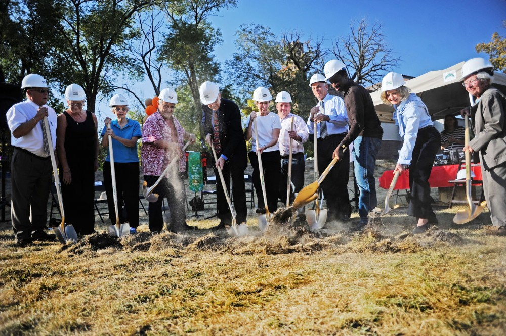 Representatives from CPM Development, Andrew Riverside Presbyterian Church and the City Council break ground for The Elysian, a new student apartment complex, Saturday in Marcy Holmes. The Elysian will be built on the site of the old church, which was demolished in 2003 after a wall collapsed, and will include dedicated space for the Andrew Riverside congregation.