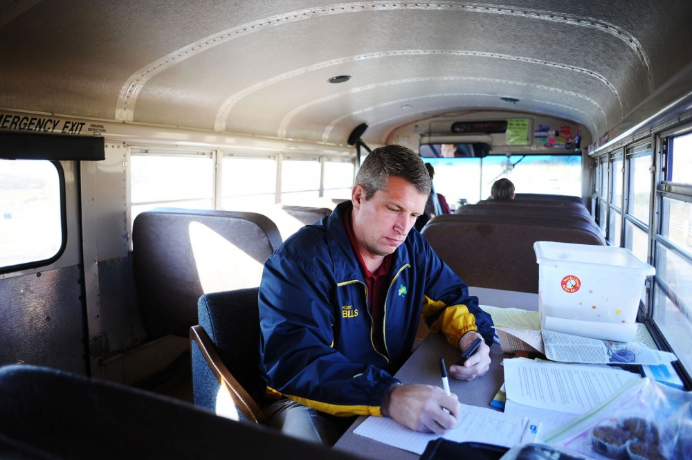 Republican Senate candidate Kurt Bills prepares for a full day of campaign stops across southwestern Minnesota onboard his modified school bus Tuesday morning en route to Mankato, Minn. Bills starts each day with a 7:30 a.m. economics class that he teaches at Rosemount High School.