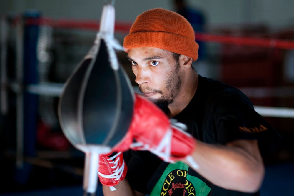 """Minnesota welterweight state champion Jamal James warms up with a double end striking bag Tuesday at Circle of Discipline in Minneapolis. """"Everybody who does this sport has a pretty big heart and has a warrior mentality,"""" he said."""