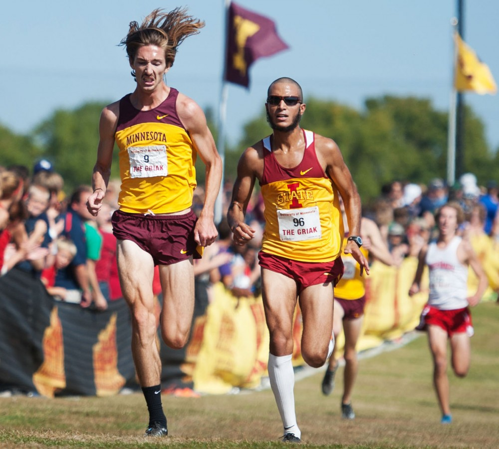 Minnesota John Simons outsprints Iowa state Mohamed Hrezi at the finish of Men's Division I Roy Griak Invitational Saturday at Les Bolstad Golf Course in St. Paul, Minn.