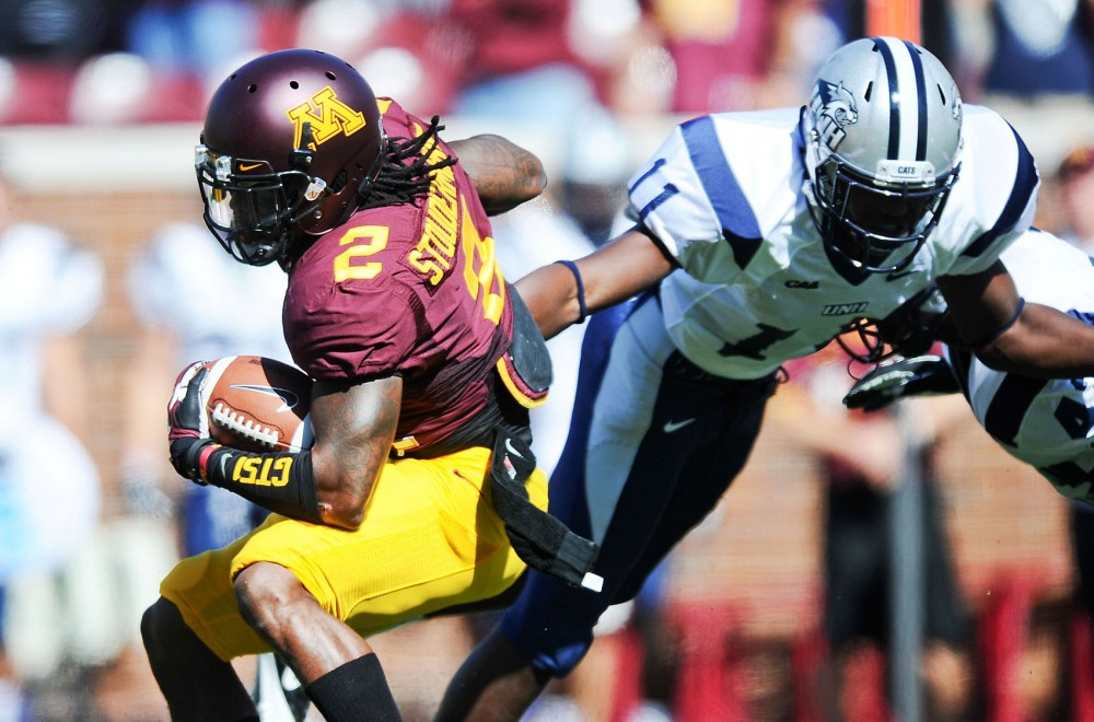 Minnesota defensive back Troy Stoudermire evades a tackle by New Hampshire safety Tre Williams on Sept. 8 at TCF Bank Stadium. The Gophers defeated the Wildcats 44-7.