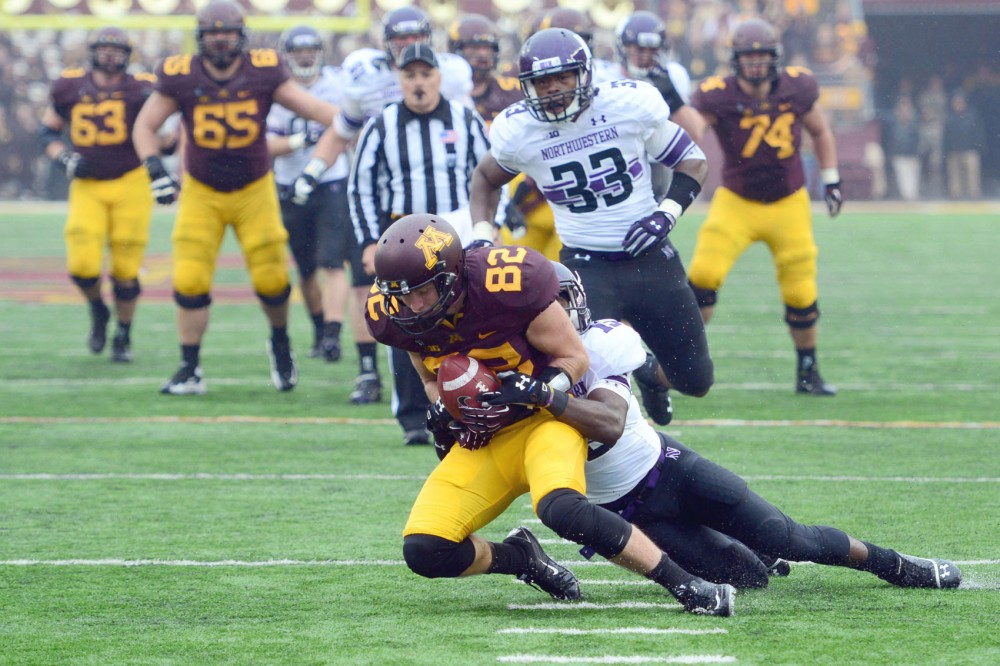 Northwestern defensive back Daniel Jones tackles Minnesota wide receiver A.J. Barker on Saturday at TCF Bank Stadium.