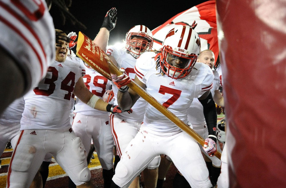 Wisconsin defensive back Aaron Henry attacks a goal post with Paul Bunyan's Axe after defeating the Badgers defeated Minnesota 42-13 on Nov. 12, 2011, at TCF Bank Stadium.