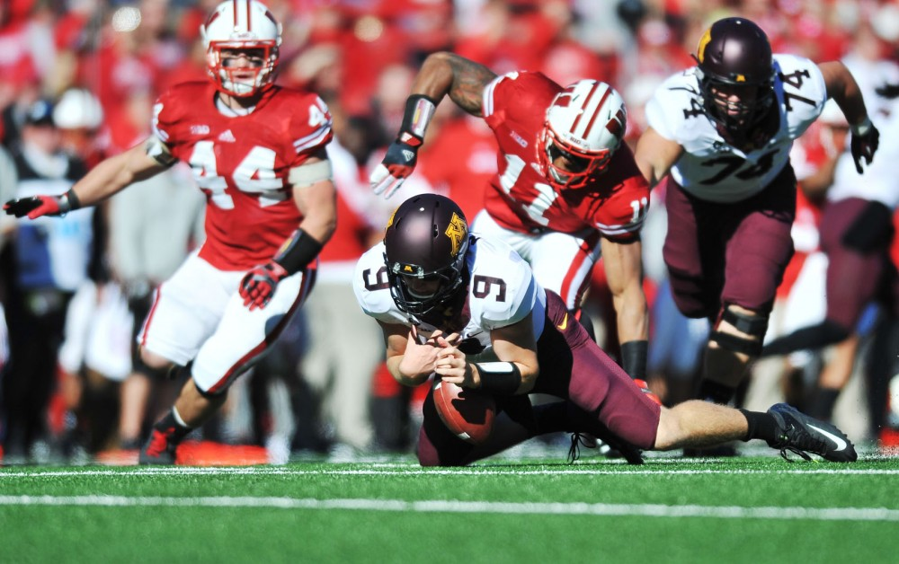 Minnesota quarterback Phillip Nelson attempts to recover a fumble during the first quarter of Saturday's game against Wisconsin at Camp Randall Stadium in Madison, Wisc. Nelson, a freshman, played all four quarters in his first game with the Gophers.