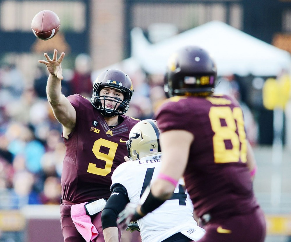 Minnesota quarterback Philip Nelson throws a pass to tight end John Rabe during Saturday's game against Purdue at TCF Bank Stadium.