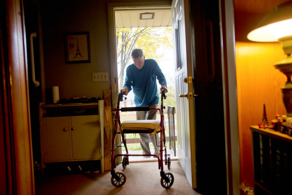 Minnesota alumnus John Carter Holmes enters his home Saturday in South Minneapolis. More modifications to Holmes's home will be completed by Freedom by Design members to make his house more accessible.