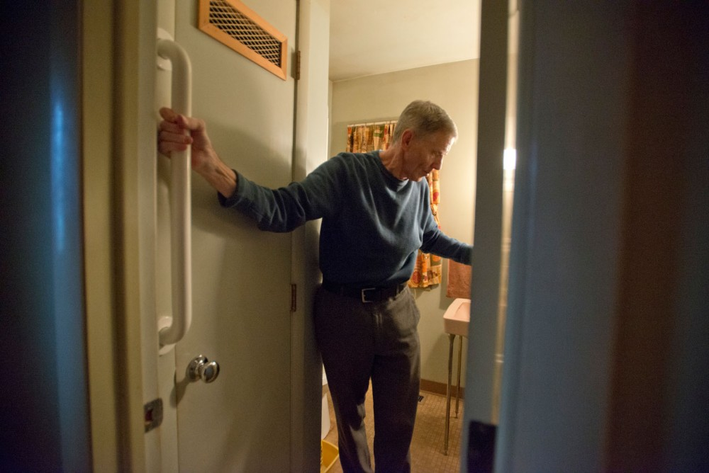 Minnesota alumnus John Carter Holmes uses the grab bar that was installed by Freedom by Design members to make his house more accessible. Holmes suffered a heart attack in 2008 and now uses a walker to get around his home.