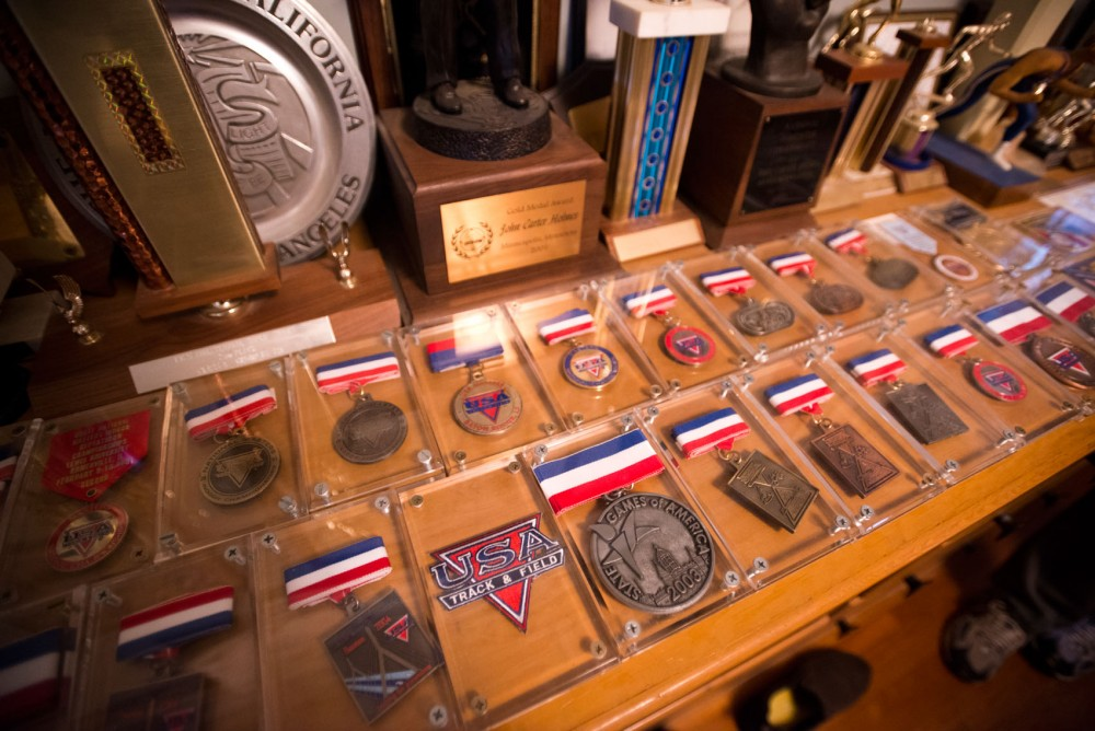 A collection of medals John Carter Holmes won throughout his running career lies on display in his home.