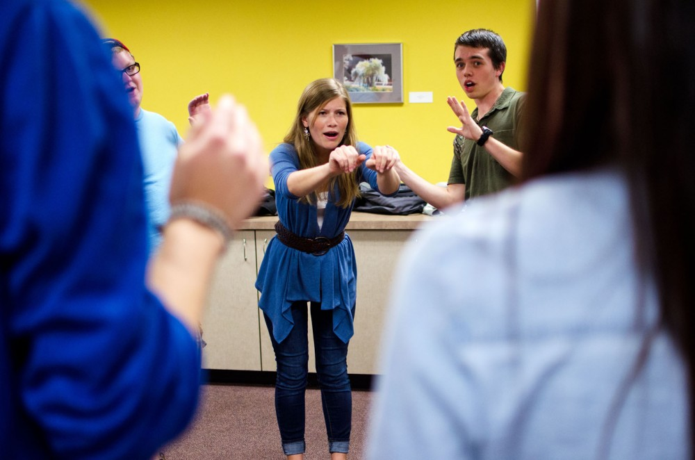 Sophomore speech-language-hearing sciences major Lauren Shibley does an improv warm-up exercise with the rest of the MinnProv teammates during their first meeting of the year at Coffman Union.