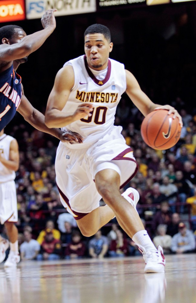 Minnesota guard Julian Welch dribbles during a game against Illinois on Jan. 28 at Williams Arena.