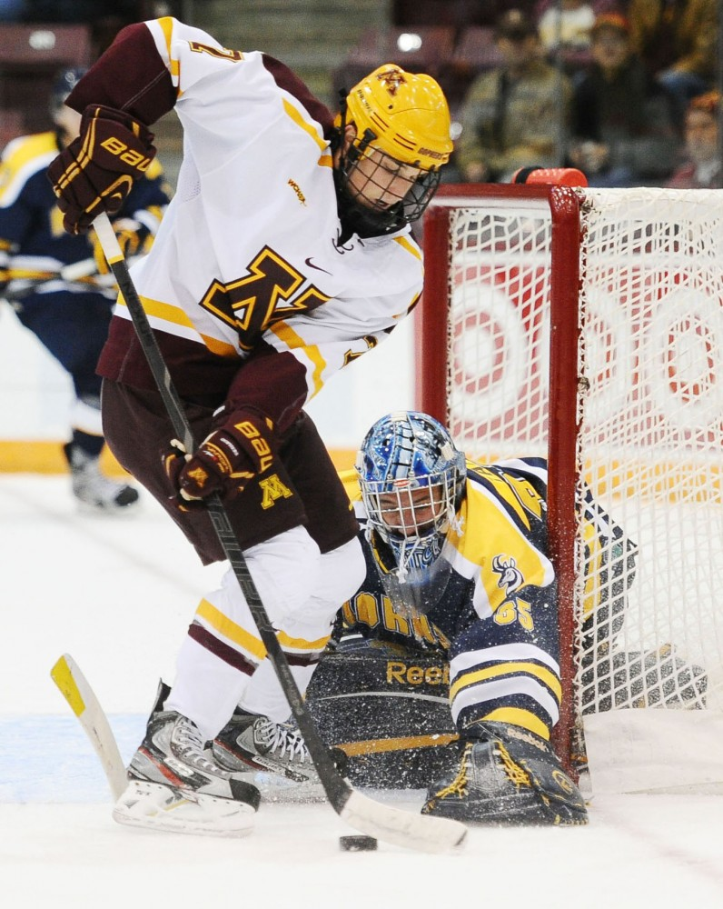 Minnesota forward Nick Bjugstad fights the puck away from Lethbridge goalie Dylan Tait on Oct. 6 at Mariucci Arena.