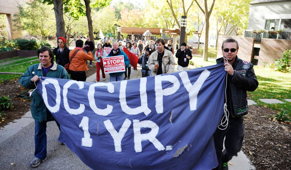 Occupy supporters march through downtown Minneapolis on Sunday after a rally at Loring Park.