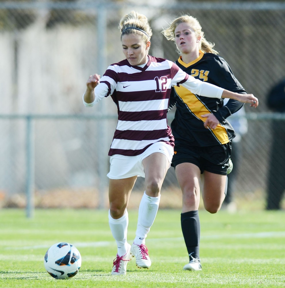 Minnesota defender Marissa Pricedrives towards Iowa;s defense Sunday at Elizabeth Lyle Robbie Stadium.