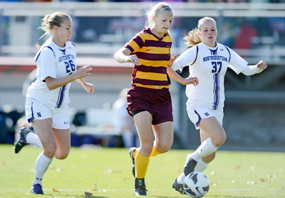 Minnesota forward Taylor Uhl pushes ahead of Northwestern defenders in Sunday's 1-0 win at Elizabeth Lyle Robbie Stadium. Uhl scored the only goal of the game, her 16th of the season. (Blake Leigh)