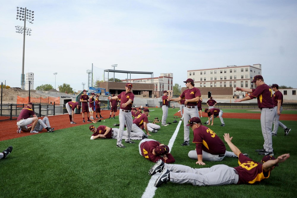 Gophers baseball players warm up before practice Sunday at Siebert Field.