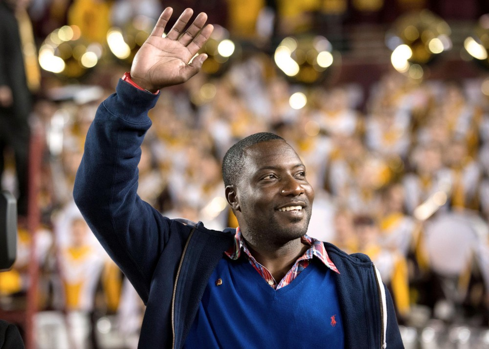 Former Gophers football player Tyrone Carter is honored during the first quarter of the game against Syracuse on Sept. 22 at TCF Bank Stadium. Carter was inducted into the M Club Hall of Fame in September.