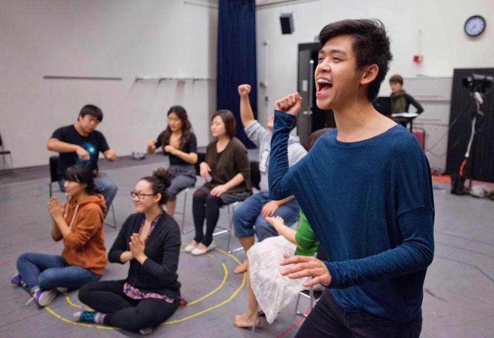Senior theater arts major Michael Phommasak rehearses a christmas scene for Under My Skin at Rarig Center.