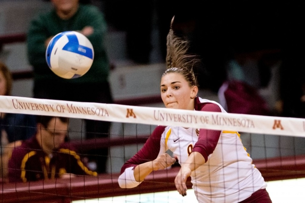 Minnesota outside hitter Katherine Harms spikes against Michigan on Wednesday at the Sports Pavilion. Harms had a match-high 20 kills as the Gophers won 3-1.