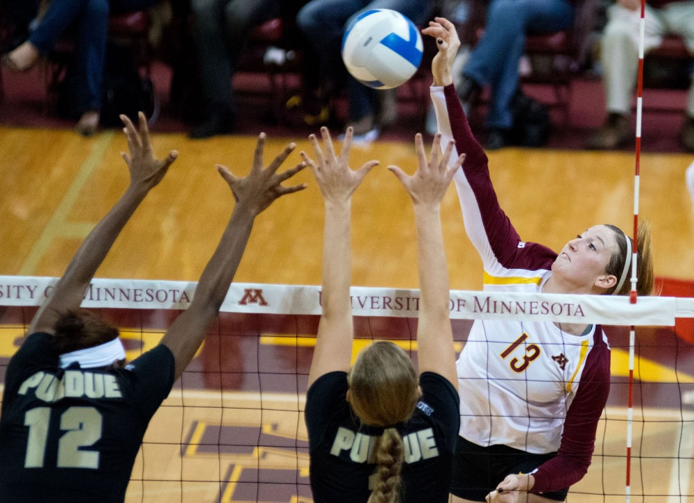 Outside hitter Ashley Wittman spikes the ball against Purdue on Saturday night at the Sports Pavilion.