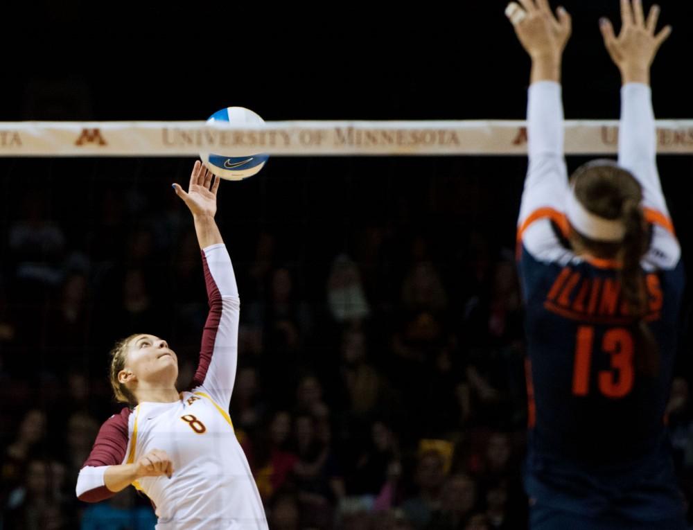Minnesota outside hitter Katherine Harms spikes the ball against Illinois on Sunday at Williams Arena.